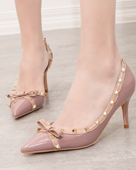 Sexy hollow rivet shoes European style slim stilettos